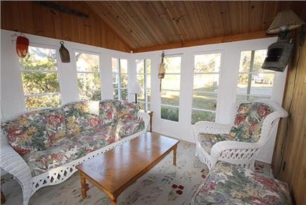 Brewster, Sea Pines Cape Cod vacation rental - Sun room off of the living room. Quiet place to enjoy a good book