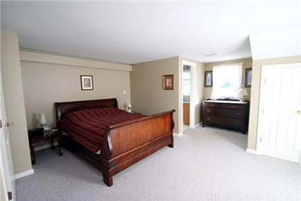 Brewster, Sea Pines Cape Cod vacation rental - Second floor master bedroom with private bath and access to deck.