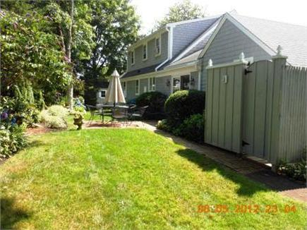 Chatham Cape Cod vacation rental - Back yard with brick patio and new enclosed outside shower