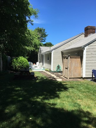 East Dennis Cape Cod vacation rental - Backyard with outdoor shower and picnic table