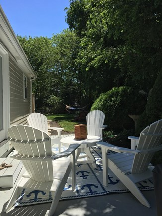 East Dennis Cape Cod vacation rental - Adirondacks and table on the patio