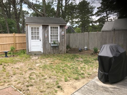 Dennis Cape Cod vacation rental - Fenced backyard with grill