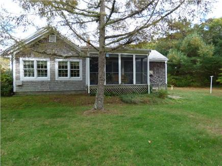 West Harwich Cape Cod vacation rental - Large back yard facing screened proch