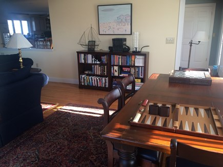 Sandwich Cape Cod vacation rental - Large tavern table with books, puzzles & board games for all ages