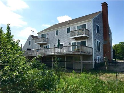 Sandwich Cape Cod vacation rental - Back of house showing deck and balconies facing salt marsh/ocean