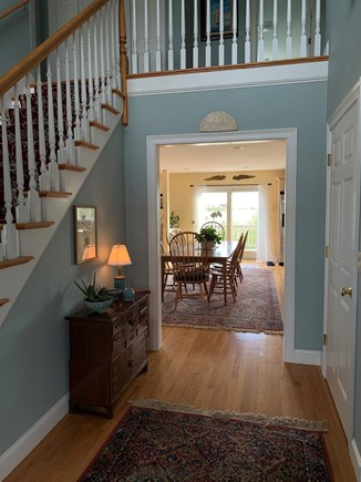 Sandwich Cape Cod vacation rental - Entry hall looking through dining area to back deck.