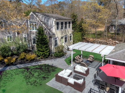 Eastham Cape Cod vacation rental - Aerial view of the firepit and pergola