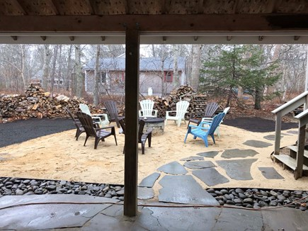 Eastham Cape Cod vacation rental - Wood firepit and walkway to one of two outdoor showers.