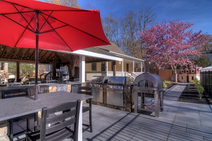 Eastham Cape Cod vacation rental - Outdoor kitchen with webber grills and new gas pizza oven.