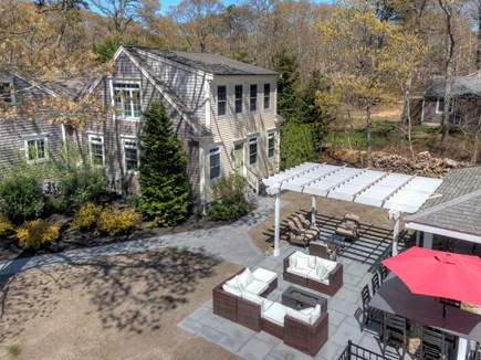 Eastham Cape Cod vacation rental - New pergola and gas fireplace.
