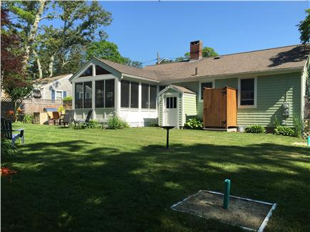 North Falmouth Cape Cod vacation rental - Fenced in back yard with horse shoe pit, patio & outdoor shower