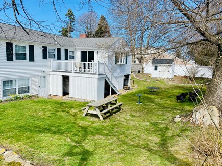 Plymouth MA vacation rental - Large manicured backyard. 2021 Trex Deck and seating for 12.