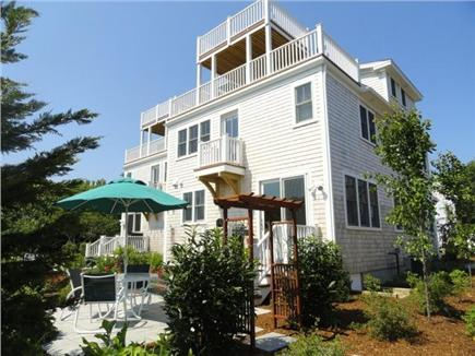 Provincetown, West End Cape Cod vacation rental - Sitting area with lush foliage, BBQ & private outdoor shower