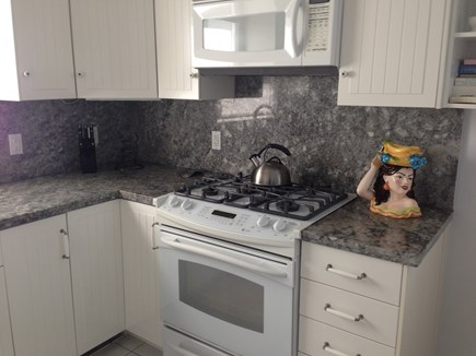 Provincetown Cape Cod vacation rental - Gas cook-top and oven, granite counter tops, and space to cook