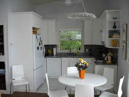Provincetown Cape Cod vacation rental - Kitchen has full-sized appliances and opens into the living area.