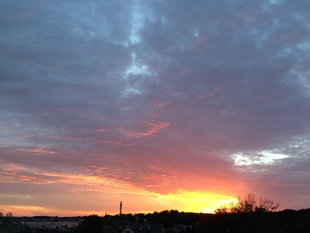 Provincetown Cape Cod vacation rental - Gorgeous sunset from roof deck. Pilgrim monument in the distance.