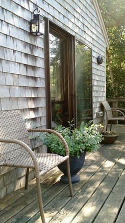 Wellfleet Cape Cod vacation rental - Spacious outdoor deck with eating table and chairs.