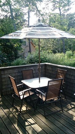 Wellfleet Cape Cod vacation rental - Outdoor dining table with four chairs.