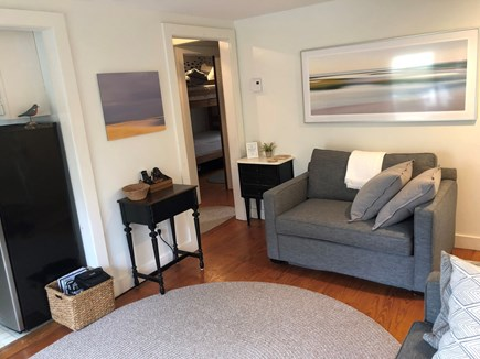Wellfleet Cape Cod vacation rental - Charming living room area with local artwork.
