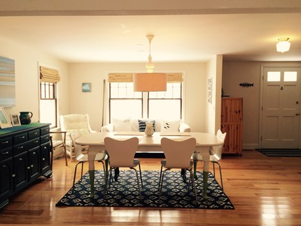 Eastham Cape Cod vacation rental - Dining room and comfy couch in the sitting area beyond