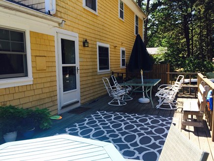 Eastham Cape Cod vacation rental - Back deck with dining table and outdoor seating