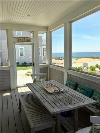 Dennisport Cape Cod vacation rental - Outdoor screened in porch for family meals