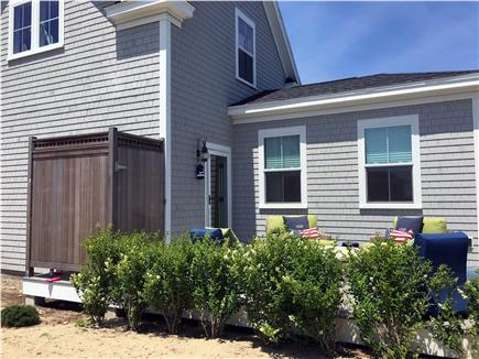 Dennisport Cape Cod vacation rental - Back porch with seating for 6 and outdoor shower