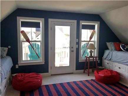 Dennisport Cape Cod vacation rental - 2nd Floor bedroom with 4 twin captains beds and balcony