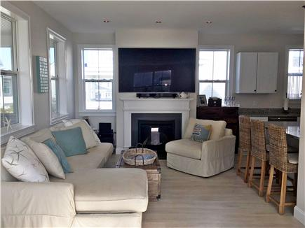 Dennisport Cape Cod vacation rental - Open family room with TV & fireplace
