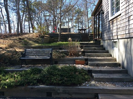 Wellfleet Cape Cod vacation rental - Stairs from driveway to backyard and screened porch entry