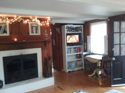 Eastham Cape Cod vacation rental - Open floor plan features fireplace and TV.