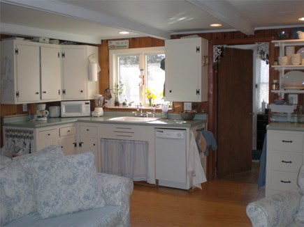 Eastham Cape Cod vacation rental - Kitchen overlooking back yard and deck.