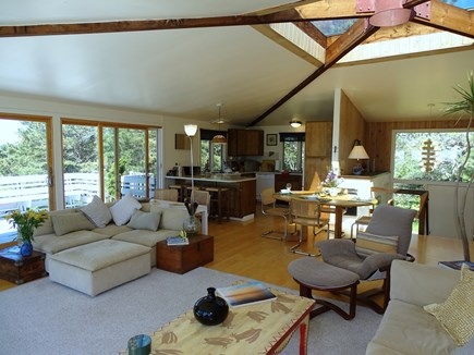 Truro Cape Cod vacation rental - Living room opens into dining and kitchen area, vaulted ceilings