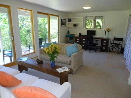 Truro Cape Cod vacation rental - Lower living room, showing sliders, desk and laundry area