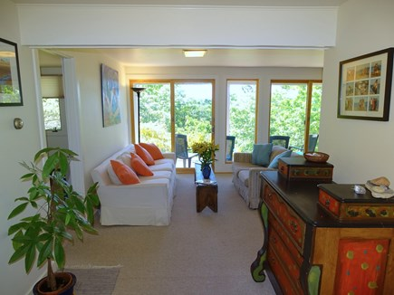 Truro Cape Cod vacation rental - Sunny lower living room w/ sitting area, sliders to back and desk