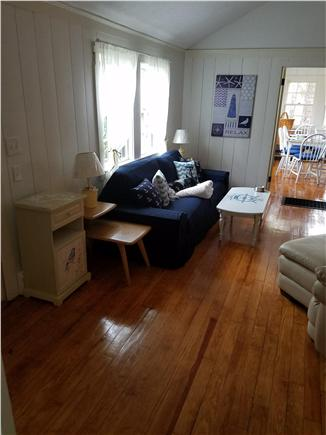 Dennisport Cape Cod vacation rental - The living room has a cozy fireplace and comfy couch