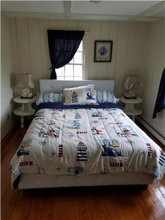 Dennisport Cape Cod vacation rental - A queen bed and 2 drawer dresser with mirror