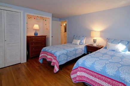 Falmouth, Belmar Cape Cod vacation rental - First floor bedroom with two twin beds, dresser, and closet.