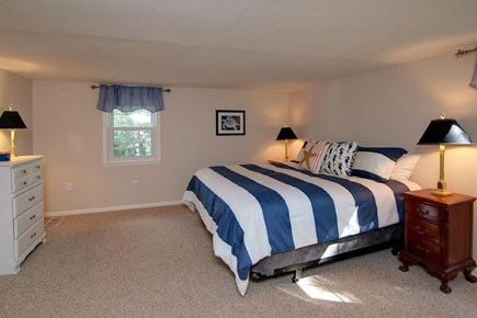 Falmouth, Belmar Cape Cod vacation rental - 2nd floor master with king bed, dresser, and large closet.