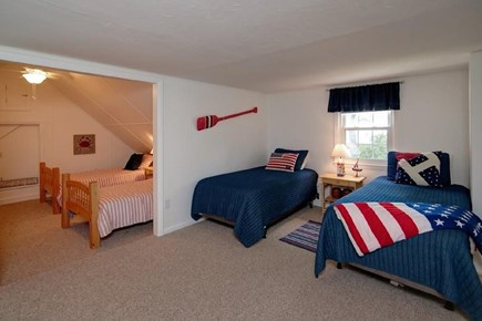 Falmouth, Belmar Cape Cod vacation rental - 2nd floor bedroom with 4 twin beds, closet, and built-in storage.