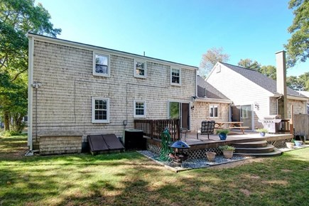 Falmouth, Belmar Cape Cod vacation rental - Large deck with outdoor hot shower, grill, and seating area.
