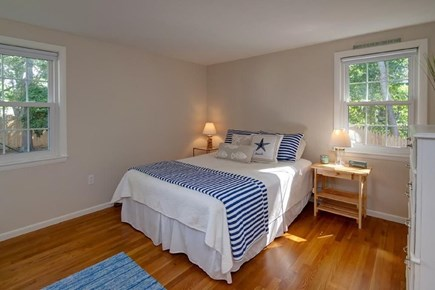 Falmouth, Belmar Cape Cod vacation rental - First floor queen bed room with dresser and closet.
