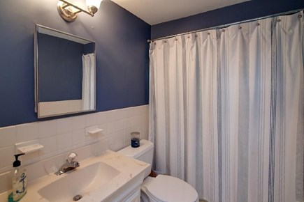 Falmouth, Belmar Cape Cod vacation rental - First floor bath with tub and shower.