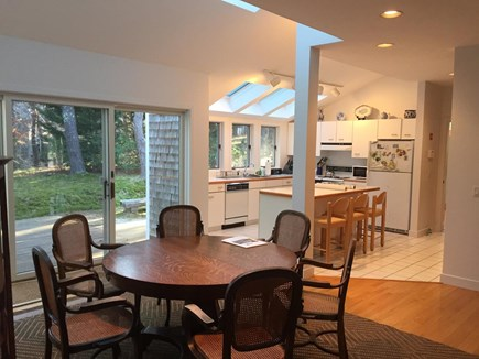 Wellfleet Cape Cod vacation rental - Dining area, kitchen, slider to deck (new chairs replace these)