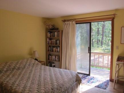 Wellfleet Cape Cod vacation rental - First floor bedroom has sliders that open up onto a deck space