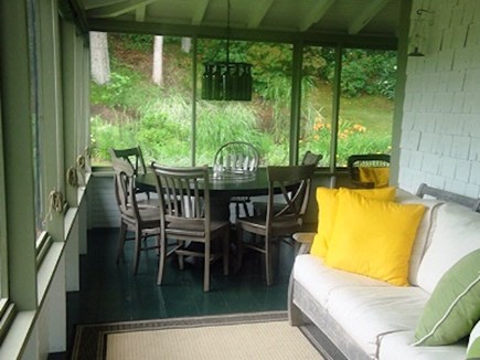 Wellfleet Cape Cod vacation rental - Nice dining and  lounging area in the screened in porch