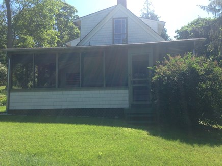 Wellfleet Cape Cod vacation rental - Screened In Porch off main house.  Has a couch and dining table