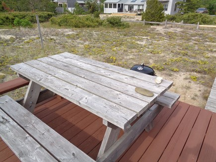 Wellfleet Cape Cod vacation rental - Picnic table on outdoor deck for al fresco dining.