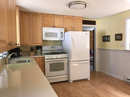 West Harwich Cape Cod vacation rental - Large kitchen with gas stove and microwave
