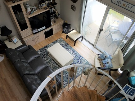 Brewster Cape Cod vacation rental - Spiral staircase from the living room to the upstairs area